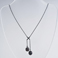 black pearl, oxidised silver cross-over necklace